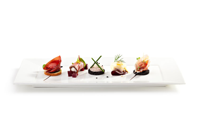 30297858 - meat canapes on white dish